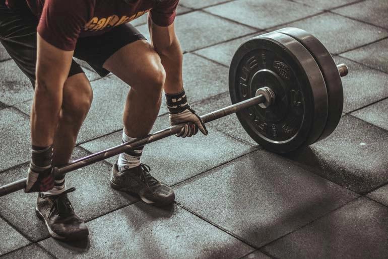 How do strength training exercises help in BJJ?